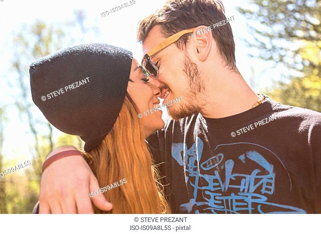 Couple kissing, woman wearing knit hat