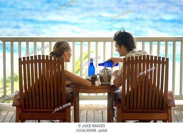 Couple on balcony near beach