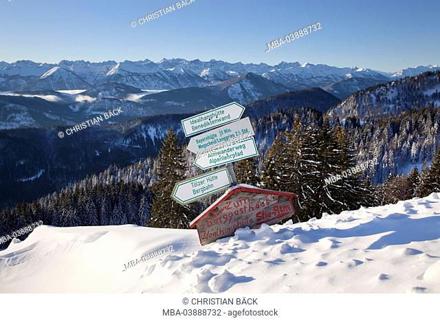 Signpost at the Strasser-Alm (alp) at Brauneck mountain with view to the Karwendel mountains, Lenggries, Upper Bavaria, Bavaria, Germany