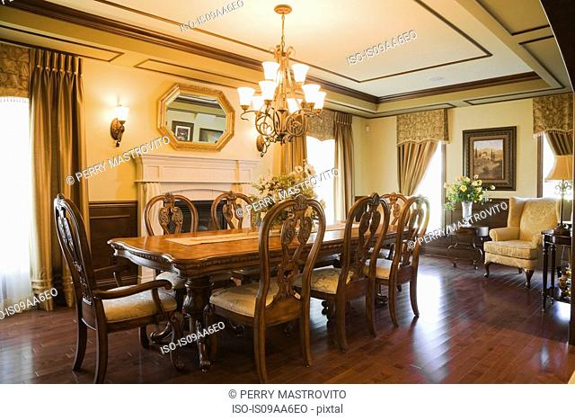 Traditionally styled dining room with wooden floor