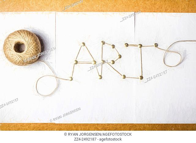 Digital illustration of a spool of string spelling out the words art utilising thumb tacks on a paper notice board. The art of fashion design