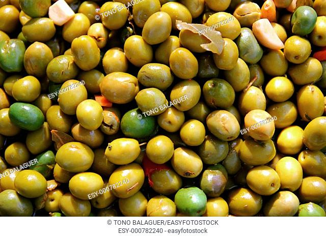olives in pickling brine pattern background texture in market