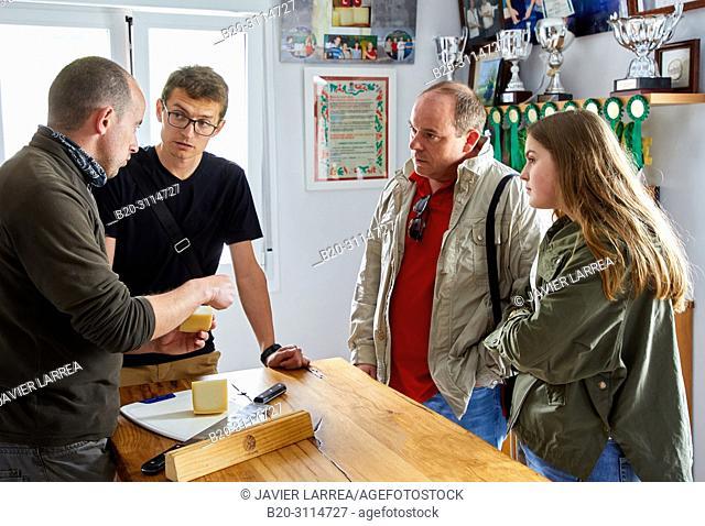 Tour guide with group, Tasting of sheep's cheese, Cheese denomination of origin Idiazabal, Caserio Mausitxa, Elgoibar, Gipuzkoa, Basque Country, Spain, Europe