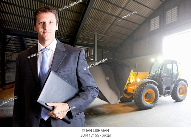 Portrait Of Businessman In Farm Grain Store