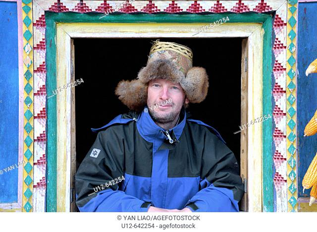 a German tourist in a traditionel tibetan house