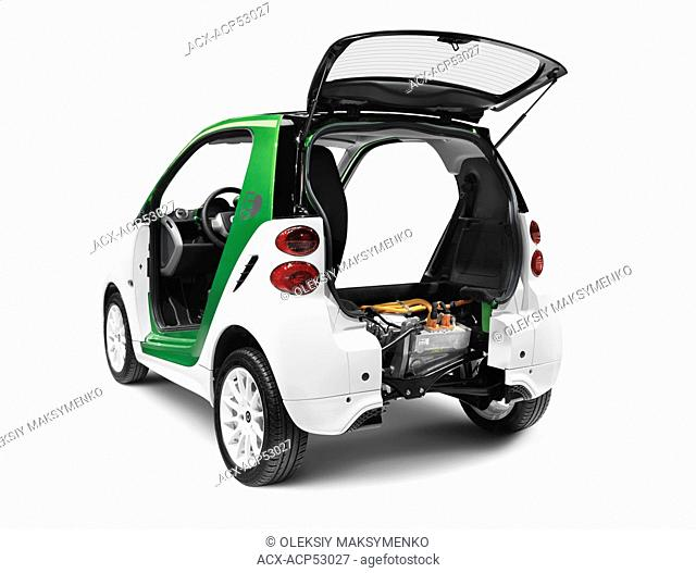 2012 Smart ForTwo Electric Drive open from behind showing the battery and the electric motor isolated on white background