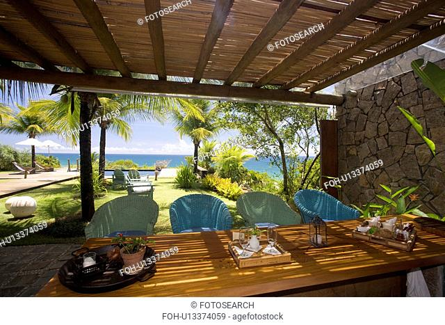 Dining table on verandah outside a brazilian Beach house