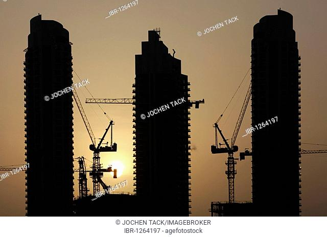 High-rise construction sites at the lake of Downtown Dubai, United Arab Emirates, Middle East