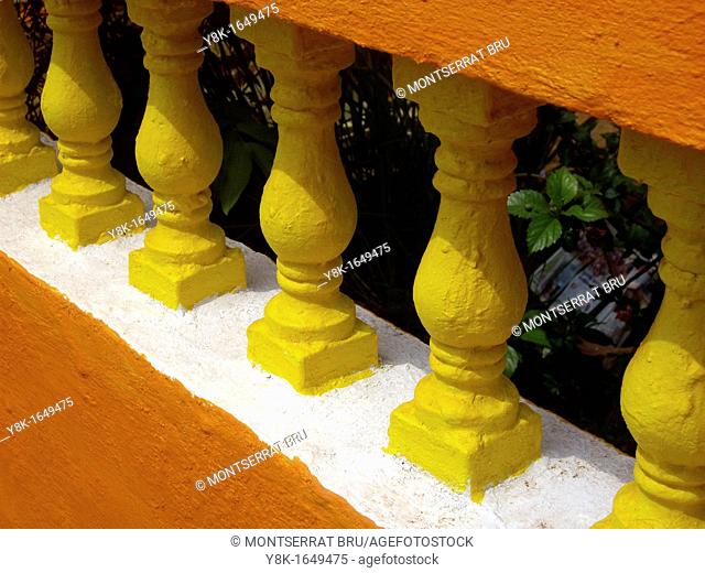 Rough painted orange, white and yellow balustrade