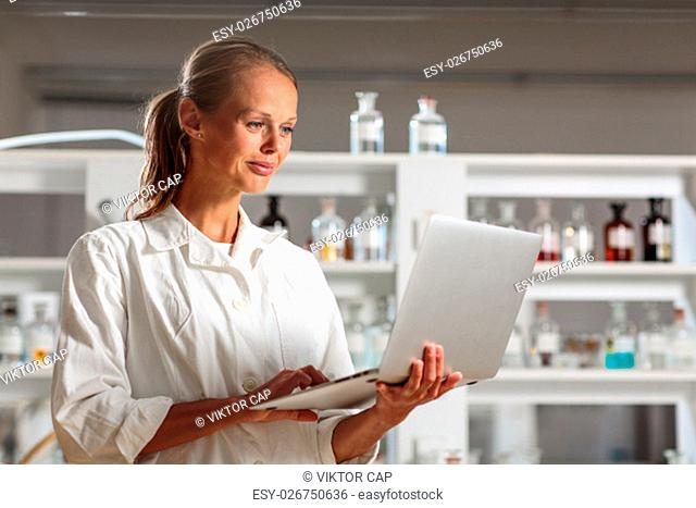 Portrait of a female researcher doing research in a chemistry lab (shallow DOF; color toned image)