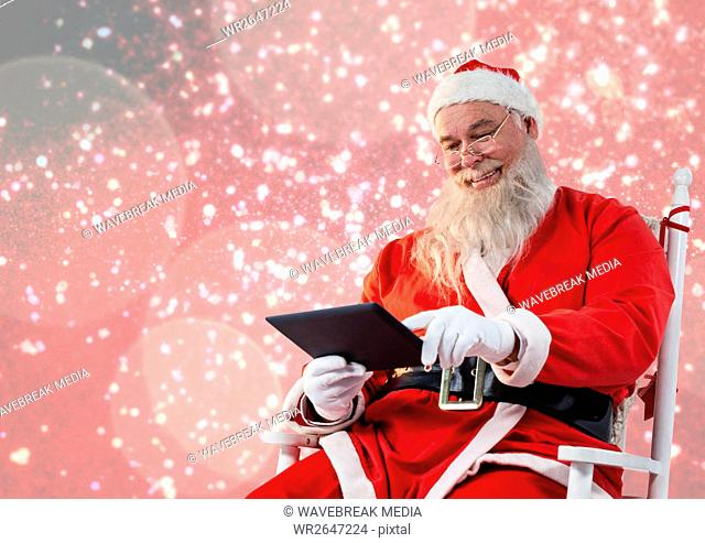 Santa claus using a digital tablet