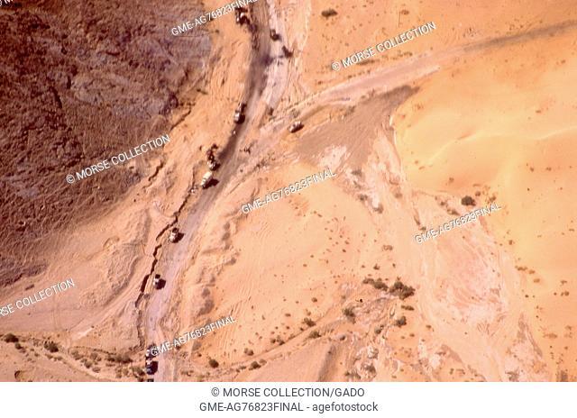 Aerial view from an airplane of trucks driving on roadways in the Sinai Desert near El Arish, Gaza, Israel, November, 1967