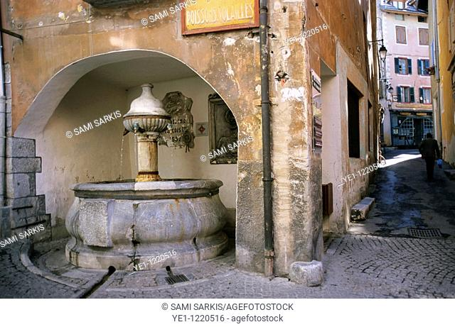 Water fountain dated ca. 1525 in the historical city of Briancon, French Alps, France