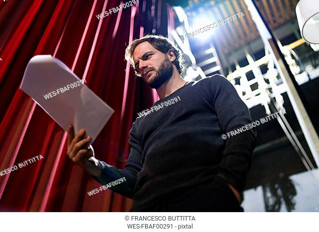 Actor rehearsing with script