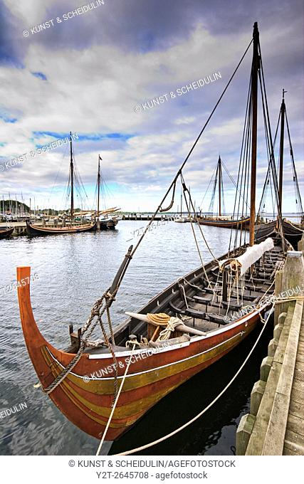 Replicas of Viking longships moored at the jetty of the Viking Ship Museum in Roskilde in Denmark