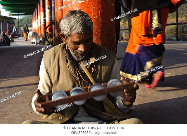 Beggar playing music ( Chitrakoot, India)