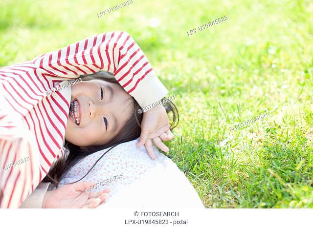 Girl lying down on picnic blanket