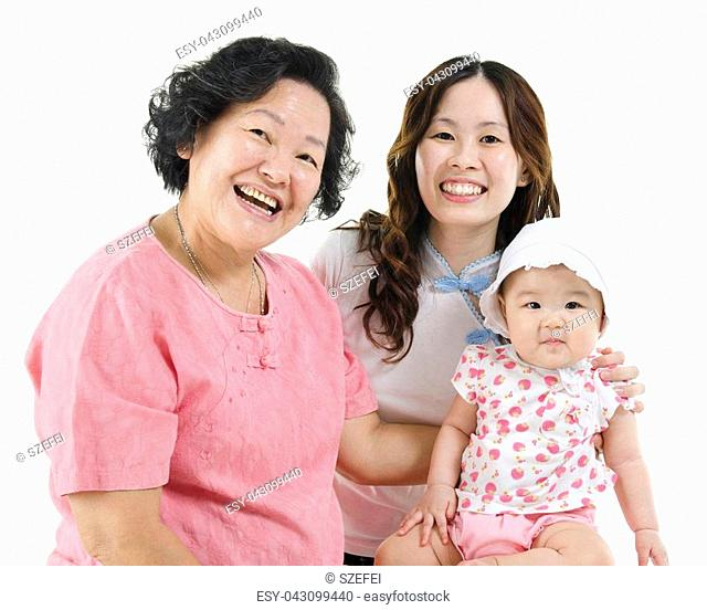 Portrait of happy three generations Asian family, grandmother, mother and grandchild, isolated on white background