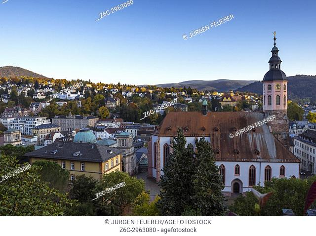 the Friedrichsbad and the Stiftskirche, panorama view over the town at the New Castle, spa town Baden-Baden at sunset, Germany