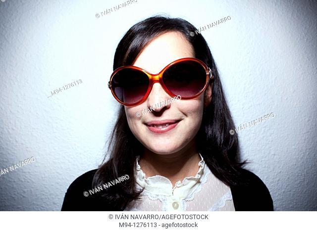 Girl with sunglassess looking at camera