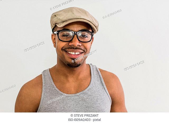 Studio portrait of mid adult man wearing flat cap