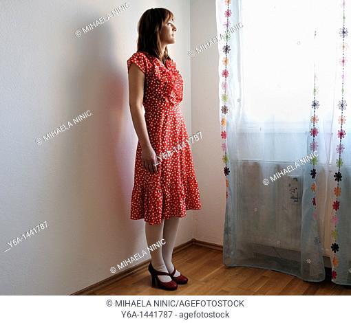 Portrait of beautiful young woman wearing polka dot dress