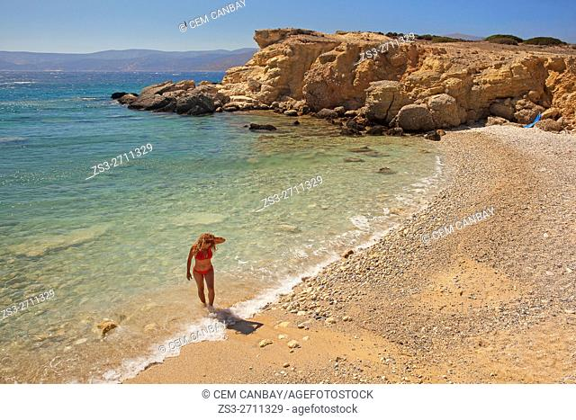 Woman in red bikini at one of the small pebbled beaches, Koufonissi, Cyclades Islands, Greek Islands, Greece, Europe