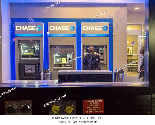 Customers use the ATM machines at a JPMorgan Chase bank in Midtown in New York