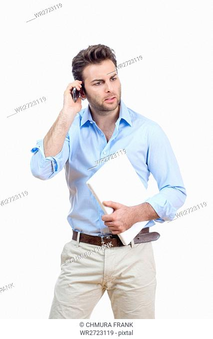 adult, alone, background, blue, casual, Caucasian, cell, cell phone, computer, face, guy, handsome, human, isolated, laptop, male, man, one, person, phone