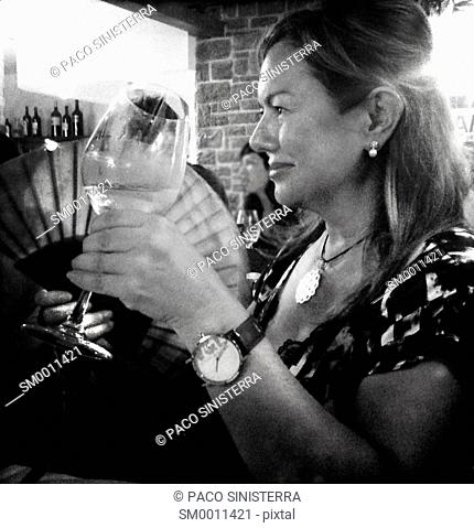 Spanish Woman drinking wine in Seville, Spain