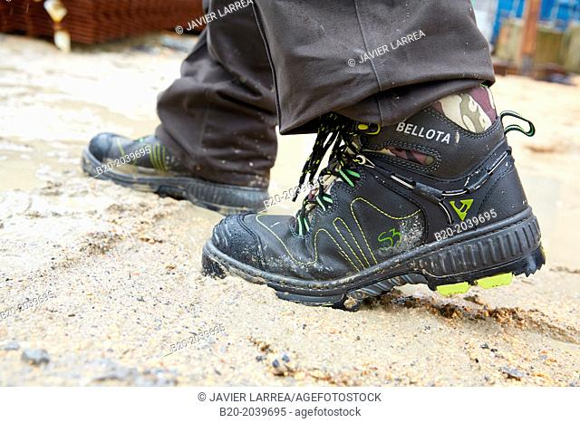 Safety shoes waterproof. Construction works. Donostia. San Sebastian. Gipuzkoa. Basque Country. Spain