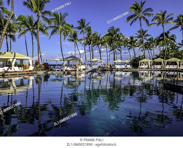 Palm tree reflections in resort pool at Wailea Beach, Maui, Hawaii, United States