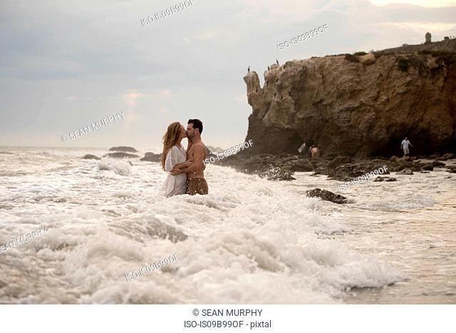 Romantic couple on beach, Malibu, California, US