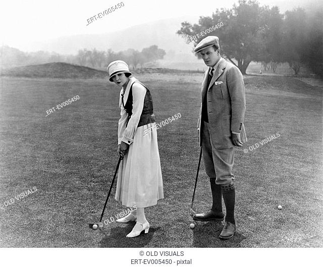 Profile of a couple playing golf in a golf course All persons depicted are not longer living and no estate exists Supplier warranties that there will be no...