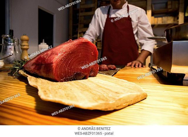 Red tuna steak on a wooden board