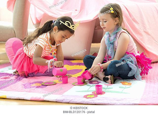 Girls having tea party