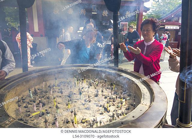 Asakusa Shinto Shrine Incense Sticks with messages Buddhist Temple Burning Tokyo Japan Asia