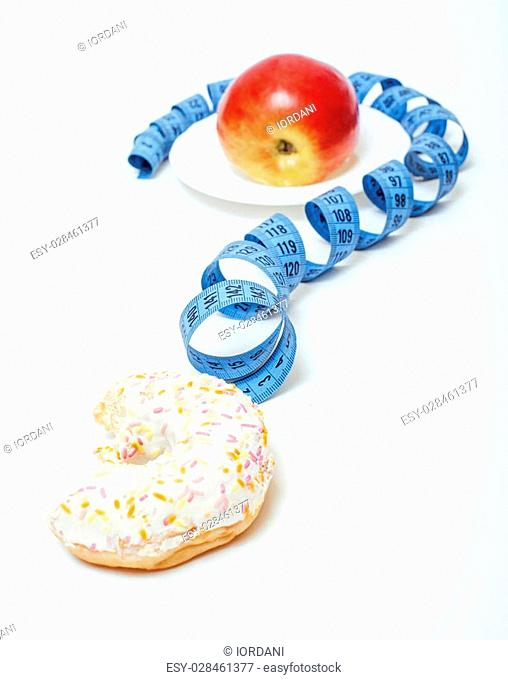 new diet concept, question sign in shape of measurment tape between red apple and donut isolated on white