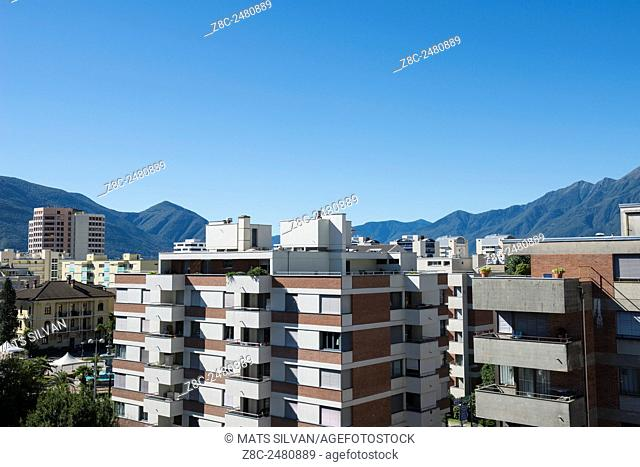 Building and mountain with blue sky in Locarno, Switzerland