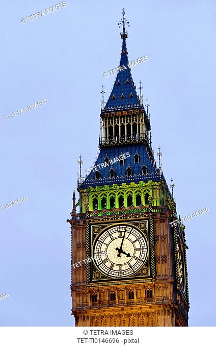 United Kingdom, London, Big Ben clock face illuminated at dusk