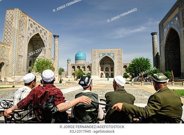 Group of locals in front of the Registan, Samarcand, Uzbekistan, Asia