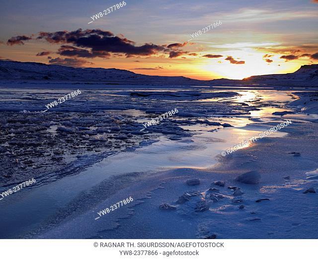 Sunset and Ice crystals in the water, Holtavorduheidi, Iceland