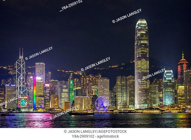 Skyscrapers on Hong Kong Island at night seen from Tsim Sha Tsui, Kowloon, Hong Kong, China