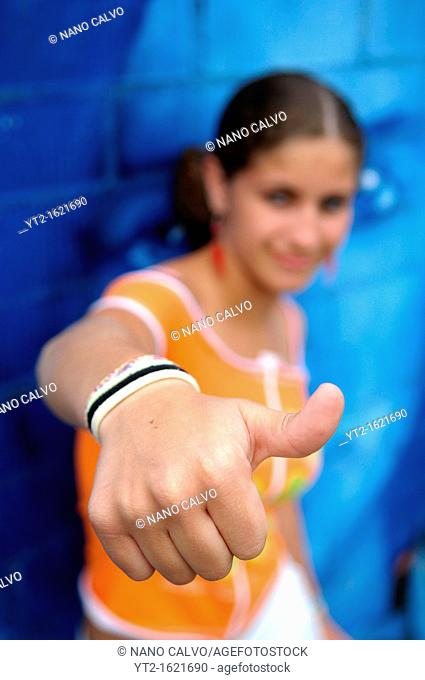 Cute teenager makes hand poses