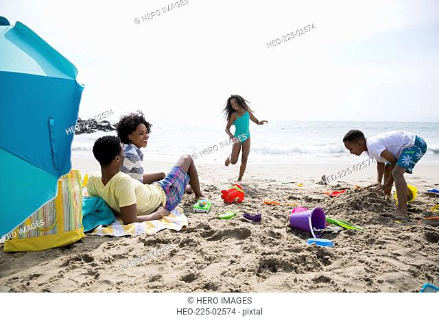 Family playing and relaxing on beach