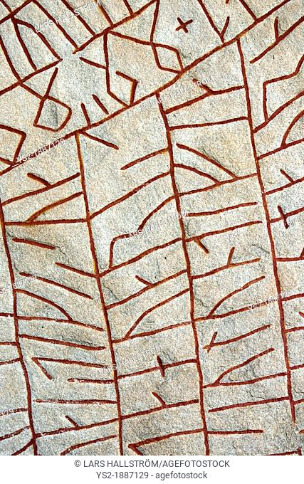 Old historic nordic runes engraved in stone  The stone is located at Rok in Ostergotland in Sweden