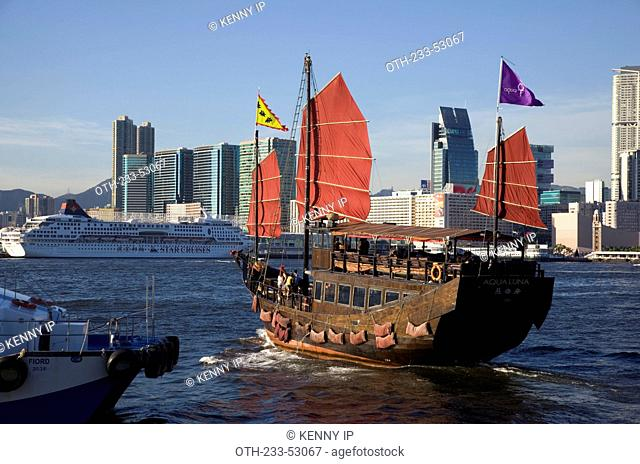 Chinese junk touring at Victoria Harbour, Hong Kong