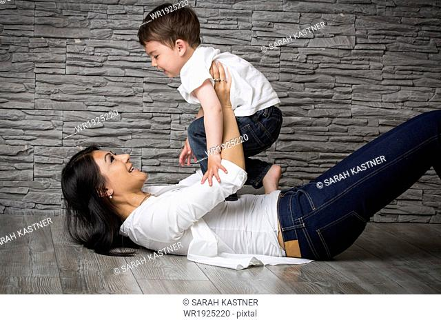 Mother and son playing on the floor