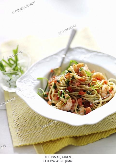Spaghetti with shrimps, spring onions, garlic and chili