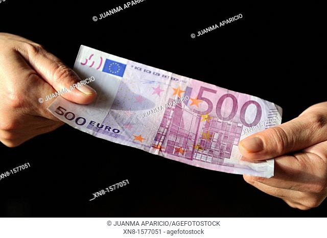 Five hundred euro banknote grabbed by two hands